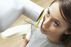 Teenage girl (14-16) having x-ray taken in dental surgery, close-up, overhead view Stock Images