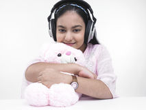 Teenage girl with headphones Stock Images