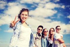 Teenage girl with headphones and friends outside Stock Photography