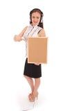 Teenage girl in headphones, holding cork board. Royalty Free Stock Photo