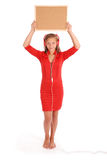 Teenage girl in headphones, holding cork board Stock Photo