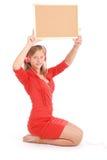 Teenage girl in headphones, holding cork board Stock Photos