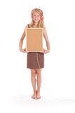 Teenage girl in headphones, holding cork board Stock Image