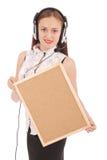 Teenage girl in headphones, holding cork board. Stock Photos