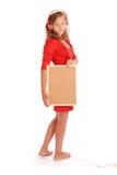 Teenage girl in headphones, holding cork board Royalty Free Stock Photo