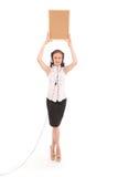 Teenage girl in headphones, holding cork board. Royalty Free Stock Images