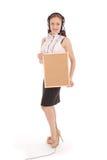 Teenage girl in headphones, holding cork board. Royalty Free Stock Image
