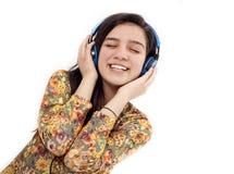 Teenage girl with headphones listening music Royalty Free Stock Photos