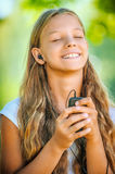 Teenage girl with headphones listening to music Stock Photo