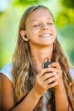 Teenage girl with headphones listening to music Stock Photo