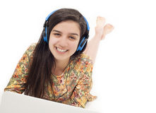 Teenage girl in headphones listening to the music Royalty Free Stock Images