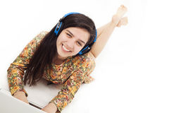 Teenage girl in headphones listening to the music Royalty Free Stock Image