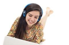 Teenage girl in headphones listening to the music Stock Photos