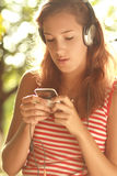 Teenage girl with headphones Royalty Free Stock Photos