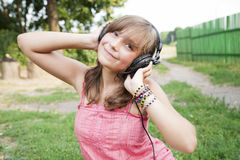 Teenage girl with headphones outdoors Stock Photos