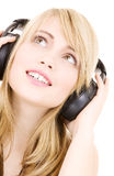 Teenage girl in headphones over white Stock Image