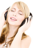 Teenage girl in headphones over white Stock Photography