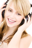 Teenage girl in headphones over white Royalty Free Stock Images