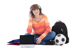 Teenage girl in headphones sitting with laptop Stock Photo