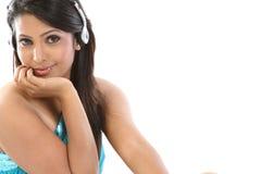 Teenage girl hearing music with headphones Royalty Free Stock Photos