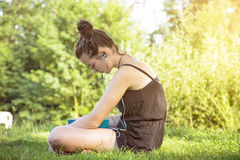 Teenage girl hears music Royalty Free Stock Photos