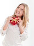 Teenage girl with heart-shaped box Royalty Free Stock Photography