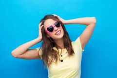 Teenage girl in heart-shaped sunglasses stock photography