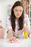 Teenage Girl Helping With Cleaning At Home Royalty Free Stock Photo