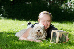 Teenage girl with her dog outside . Stock Photos