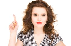 Teenage girl with her finger up Royalty Free Stock Image