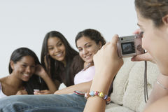 Teenage girl with her friends. Royalty Free Stock Photos