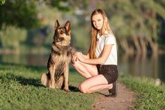 Teenage girl with her german shepherd in park Stock Photography
