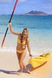 Teenage girl with her kayak Royalty Free Stock Image