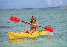 Teenage girl with her kayak Royalty Free Stock Photos