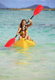 Teenage girl with her kayak Stock Photography