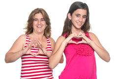 Teenage girl and her mother doing the heart sign stock photos
