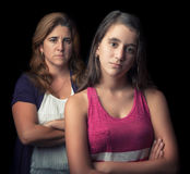 Teenage girl and her mother sad and angry Royalty Free Stock Photos