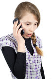 Teenage Girl With Her Mouth and Eyes Wide Open Expressing Surprise Emotion While Talking on Her Mobile Phone. Half Length Studio Shot Isolated on White Stock Photo