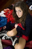 Teenage girl in her room. Teenage girl sitting on the floor of her messy room. She looks at you a bit angry Royalty Free Stock Photography