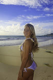 Teenage girl with her surfboard Royalty Free Stock Photo
