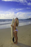 Teenage girl with her surfboard Stock Photography