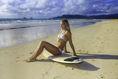 Teenage girl with her surfboard Royalty Free Stock Image