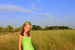Teenage girl among the high grass Royalty Free Stock Images