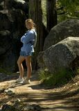 Teenage girl on a hiking trail. Young girl on a hiking trail in the mountains Stock Photos