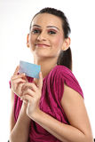 Teenage girl holding a  bank or credit card. Beautiful Teenage girl  holding a membership card, bank or credit card, business card Stock Images