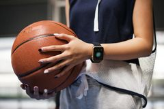 Teenage girl holding a basketball on the court Royalty Free Stock Photos