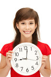 Teenage girl holding big clock Stock Photos