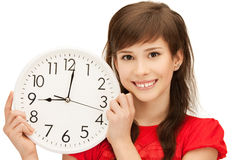 Teenage girl holding big clock Royalty Free Stock Image