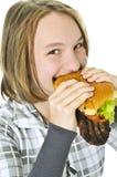 Teenage girl holding big hamburger Stock Images