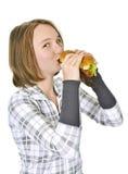 Teenage girl holding big hamburger Royalty Free Stock Images